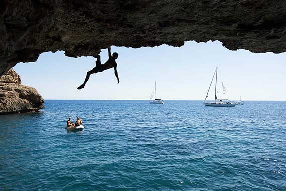 Deep water solo in Majorca. Climb and sail in Spain